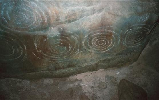 Carved stone inside the chamber of Barclodiad y Gawres (Anglesey).( Wales )