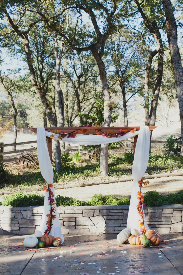 Rustic fall wedding arbor