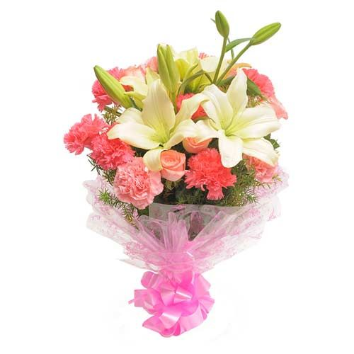With carnations, roses, and lilies packed in an elegant way, convey your feelings to your loved ones in style. This bunch of flowers is an arrangement of 10 pink carnations, 5 pink Roses, and 2 Asiatic white lilies with some fillers wrapped in cellophane and tied with a ribbon bow. Order this product from Ferns N Petals online now, and gift a moment of happiness in style. http://www.fnp.com/flowers/friendship-day-flowers/pink-style/--clI_2-cI_2824-pI_27389-i_26995.html