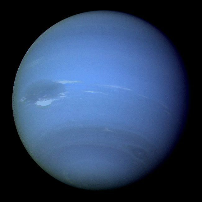 Neptune, the coldest planet in our solar system with the strongest winds and a gravity pull that is closest to Earth's, yet with 17 times the mass of Earth.