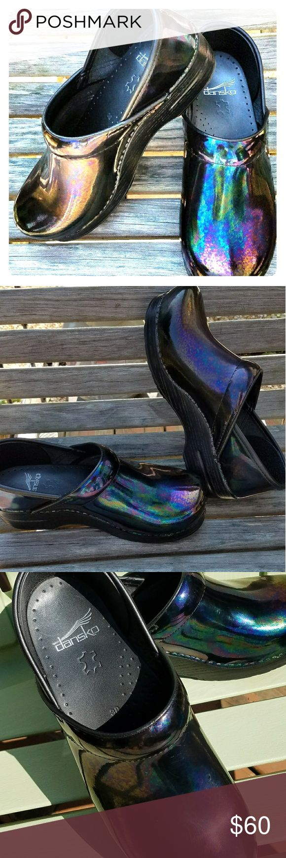 Dansko Oil Slick Professional Nursing Clogs/ Mules Excellent condition. Any slight imperfections are shown in the pictures. Worn twice. Shimmers in the light to create an array of purple, green, and blue colors. Dansko Shoes Mules & Clogs