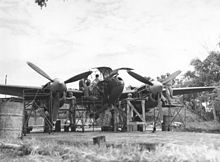 """US Army AF - Lockheed P-38 Lightning - Ground Crew Members of the 459th Fighter Squadron, Nicknamed the """"Twin Dragon Squadron"""", Working on a P-38 at an Air Base in Chittagong, India – January 1945"""