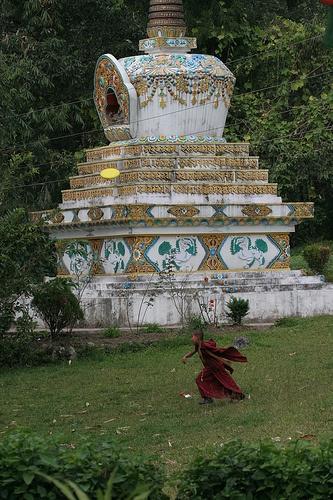 Besides the beautiful Stupa, a little monk playing frisbee is a beautiful sight.