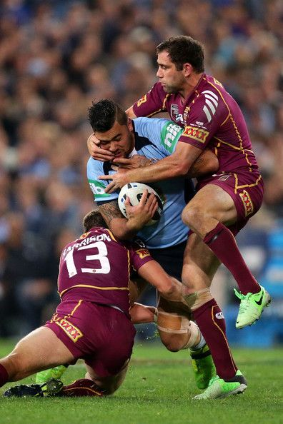 Andrew Fifita of the Blues is tackled during game one of the ARL State of Origin series between the New South Wales Blues and the Queensland Maroons at ANZ Stadium on June 5, 2013 in Sydney, Australia.