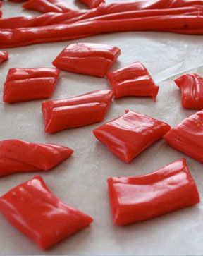 Kool-Aid Taffy: 2 1/2 cups sugar   3 tablespoons cornstarch   1 cup light corn syrup   1 1/3 cups water   2 tablespoons butter softened, plus more for buttering hands   1 teaspoon salt   1 package (6g) black cherry Kool-Aid (or any unsweetened fruit flavored drink mix)   1/2 teaspoon vanilla extract