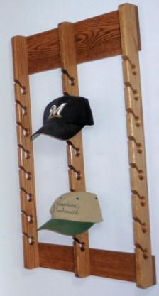 Organize your guy or dad's baseball caps with a handcrafted cap rack. Available in 3 sizes. Pick stain that matches your home.