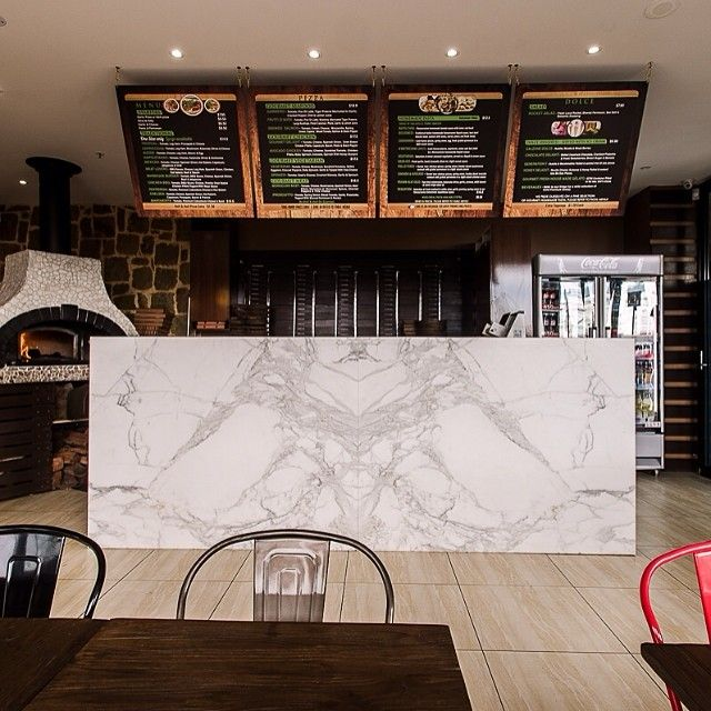 Pizza Dolce in Chelsea featuring Calacutta premium honed marble for its reception / servery. Stone manufactured and installed by Granite Planet www.graniteplanet.com.au