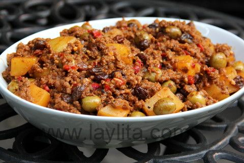 Cuban Picadillo. I have never combined potatoes with minced beef before into a stew with green olives, raisins and and and!!! Looks totally awsome. This gets on my list.