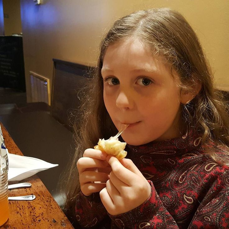 Hunter who is not a fan of melted cheese is really going to town on the ham and cheese empanadas at Buenos Aires Grill and Cafe in Little Rock's River Market District. #empanadas #hamandcheese #buenosairesgrillandcafe #littlerockeats #littlerockrestaurants #littlerock #arkansasfood #rivermarket