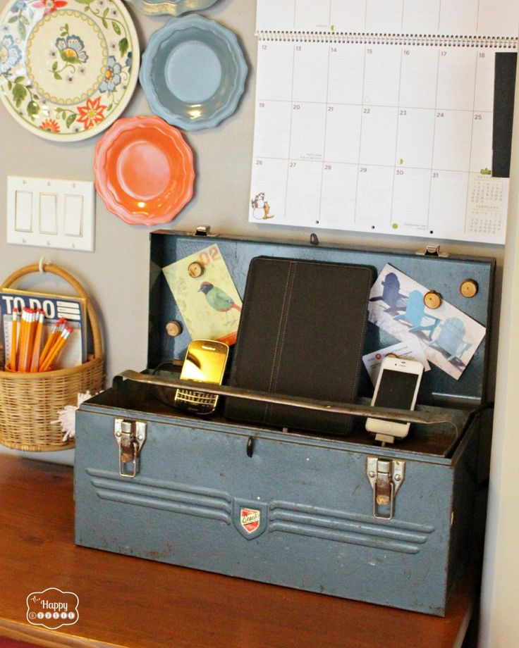 Charging Station from a Vintage Tool Box.. I love this, since I am SICK of looking at the cords all over my kitchen counters.  Maybe I could do it with an old breadbox or something more appropriate for the kitchen.