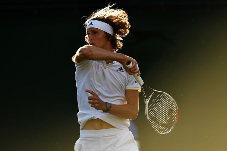 Alexander Zverev Photos - Alexander Zverev of Germany plays a forehand during the Gentlemen's Singles fourth round match against Milos Raonic of Canada on day seven of the Wimbledon Lawn Tennis Championships at the All England Lawn Tennis and Croquet Club on July 10, 2017 in London, England. - Day Seven: The Championships - Wimbledon 2017