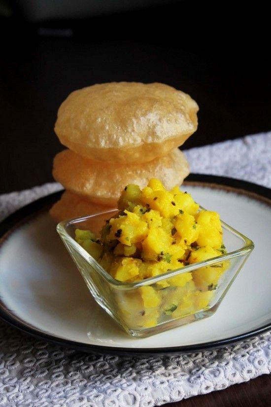 Poori Bhaji Recipe or puri bhaji recipe with step by step photos - mild potato subzi served with puffed pooris. A popular Mumbai street food