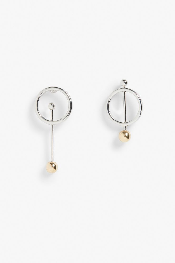 Exuding asymmetric coolness, these ring and rod earrings are perfection. Push back fastening.
