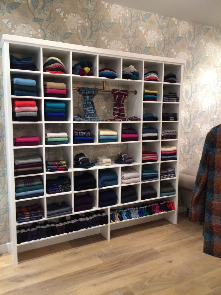 We want this wall of knitwear in our office! Shop fit of the Brora store in New York.