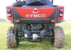 """The rear of the UXV 450i. Notice the beefy steel frame, adjustable shocks, and 2"""" receiver hitch. A storage compartment is behind the tailgate outer panel as well."""