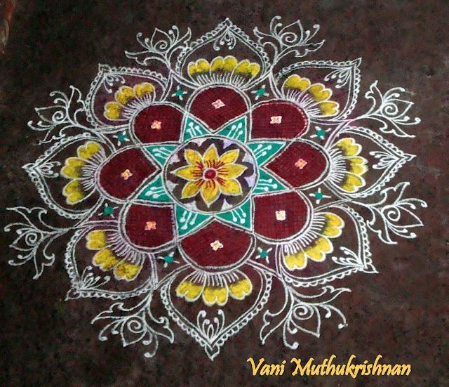 rangoli design - so few colors and yet so pretty