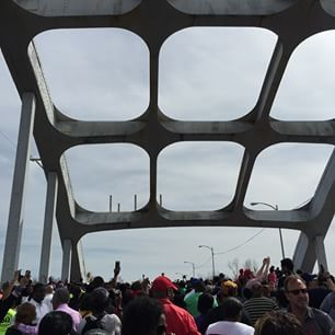 A huge crowd came to the bridge, where 50 years ago peaceful civil rights demonstrators were attacked by armed officers. | Selma Bridge Crossing Almost Canceled Due To Large Crowd Numbers, But Demonstrators March On - BuzzFeed News