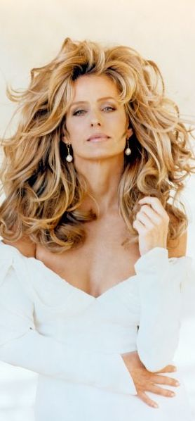 Farrah Fawcett-  my hair history... Flicked, leonine mane, tumbling forever curls... That was then... Not now