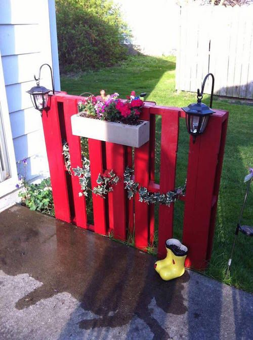 DIY Pallet fence. So cute! Hang lanterns and a flower box. Great idea -