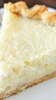 Old Fashioned Coconut Custard Pie ~ Similar to what you would imagine a coconut crème brulee might be... The flaky pie crust is filled with loads of shredded coconut set in a baked custard.