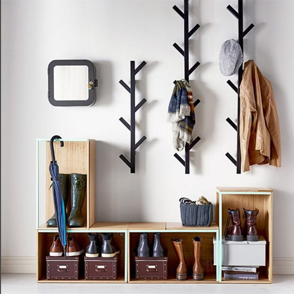 Avoid entryway clutter with open storage boxes for shoes and racks for hats and jackets.  #refinery29 http://www.refinery29.com/organized-decor-inspiration#slide-7