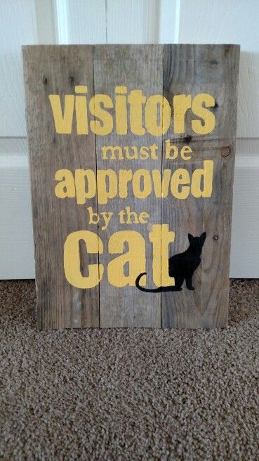 Visitors must be approved by the cat -- pallet sign