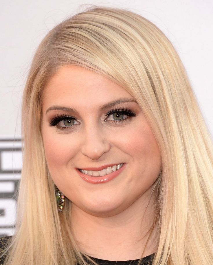 Megan Trainor - This lady is so pretty but has yet to really tap into what makes her so special.  This is basic beauty queen makeup - its almost good but just a few tweaks would make it stunning.  Her skin looks too heavily powdered and the lashes are too heavy for her eye shape.