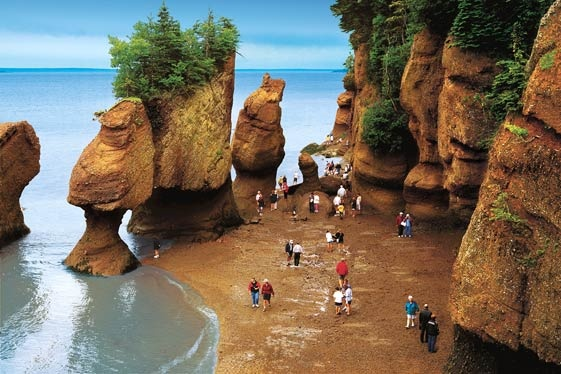 People walking on the ocean floor at Hopewell Rocks in New Brunswick. Photo: New Brunswick Tourism and Parks