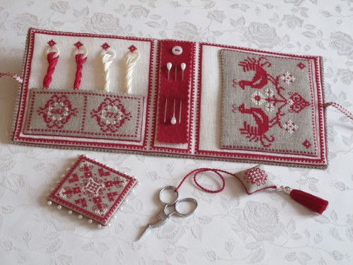 I like the way the floss has rings and pockets - to keep it organized - - - needle case inside cross stitch red