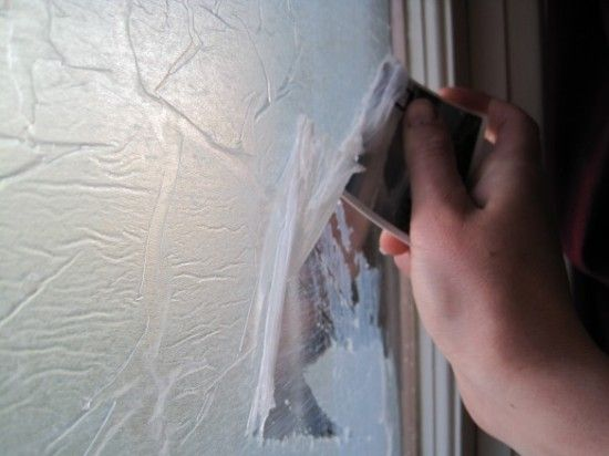 I went to the home improvement store and found semi-transparent adhesive window films, but they cost $20 per window!  With three windows to cover, I knew I'd need to find a cheaper option.  In fact, I found a way to do it with just stuff I already had so the whole project was FREE!  Here's how to put it up AND take it down.