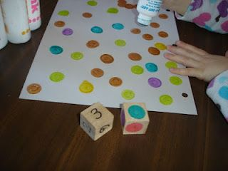 """Dot counting game: turns rolling a number die and the color die. If we rolled a """"3"""" and a """"teal"""" then we would put 3 teal dots on a piece of paper. We weren't making any special pictures, we were just going to play until the paper was filled up"""