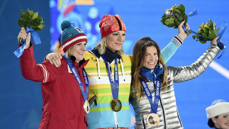 Through the lens: Day 3 From left: Austrian Nicole Hosp, German Maria Hoefl-Riesch and American Julia Mancuso receive their medals for the women's super combined event.