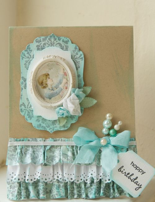 card with gathered fabric and lace, stick pins, small framed picture