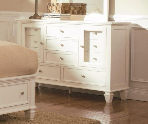 Glenmore Dresser by Wildon Home. $1172.04. Simple silver tone knobs. Clean lines. Classic molding. Square tapered feet. Eleven Drawers in Various Sizes. Add this dresser to your classic master bedroom for a style update. The piece has tons of storage, with 11 drawers in various sizes to meet all of your bedroom storage needs. From bulky clothing items to smaller dedicates and jewelry, there is a drawer to fit. Two distinctive transparent doors add a unique touch, whil...