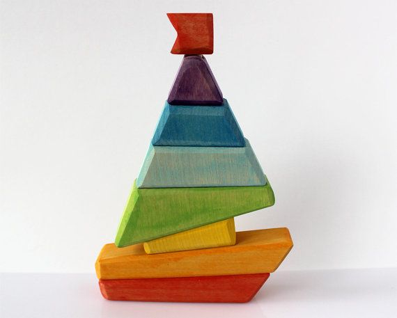 I absolutely love this little sailboat toy from Russia! There are also some other really cute wooden toys in this etsy shop. Stacking Toy - Sailfish Wooden Toy - Natural Wood Toy Baby Kids Montessori Game