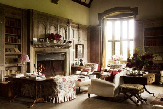 The wood-panelled library at Wardington Manor in Oxfordshire features a chintz sofa. Floral fabrics and motifs appear throughout the house, reflecting the passion of owner Bridget Elworthy, one half of garden design duo The Land Gardeners, whose new business venture into cut flowers is based at the manor.