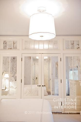 love the idea of vintage looking french doors/transoms with mirrors in them as the wardrobe wall