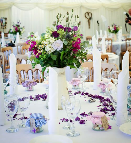 natural and beautiful table centrepieces with a scattering of petals