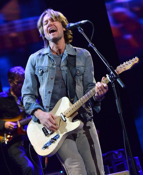 Keith Urban Photos Photos - Keith Urban performs on stage during the 2013 Crossroads Guitar Festival at Madison Square Garden on April 13, 2013 in New York City. - Eric Clapton's Crossroads Guitar Festival 2013 - Day 2 - Show