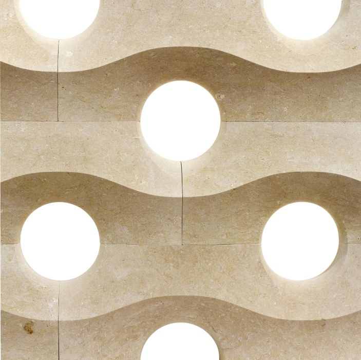 """Born within the """"I Marmi del Doge"""" project, this modular partition wall makes of a series of circular voids its distinguishing feature, reinterpreting the fretwork in the """"loggia"""" of the Doges Palace in Venice. Our """"ducale"""" dividing wall from the """"Muri di Pietra"""" collection."""