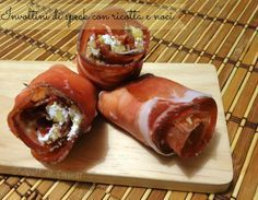 Italian recipe: involtini di speck con ricotta e noci (walnuts): easy and flavorful. you could probably substitute prosciutto if you can't find speck in a local gourmet italian shop