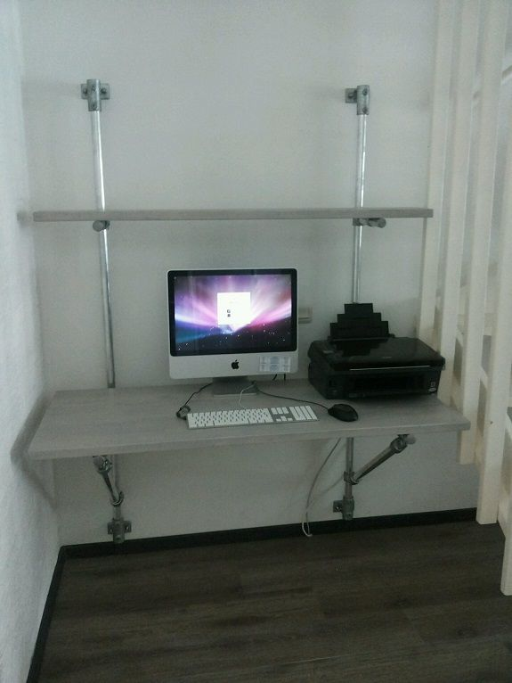 wall mounted desk that is supported with kee klamp fittings