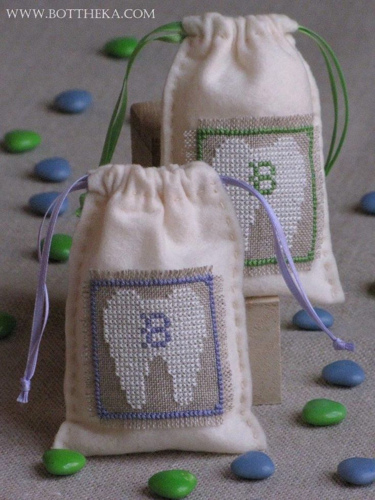 Little milk tooth bags cross stitch FREE http://bottheka.com/en/little-milk-tooth-iii