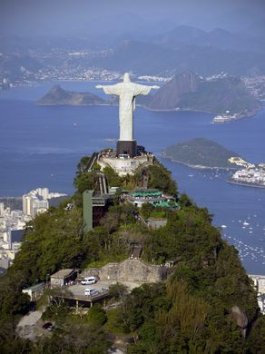 An aerial view of Christ the Redeemer statue on top of Corcovado mountain overlooking Guanabara Bay in Rio de Janeiro.