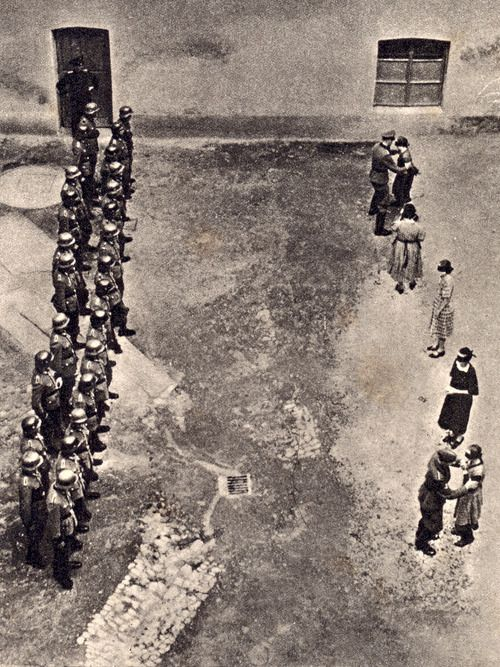 Five women are lined up in front of a German firing squad. The execution of hostages, especially women and children, was often used in retaliation of resistance. Celje, 1942.