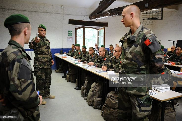 Young recruits of the French Foreign Legion attend a French class at 'The Farm', a training center near Castelnaudary, southwestern france, on June 16, 2015.