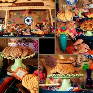dessert table with traditional mexican sweet bread and pastries