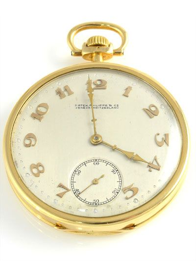 Vintage Swiss 18K yellow gold pocket watch by Patek Philippe for Grogan & Co. Pittsburgh. This pocket watch crafted in 18 karat yellow gold features an open face case with original silver dial, a high grade 20 jewel movement, adjusts to eight positions, 45mm case, circa 1917. Restored with one year warranty.