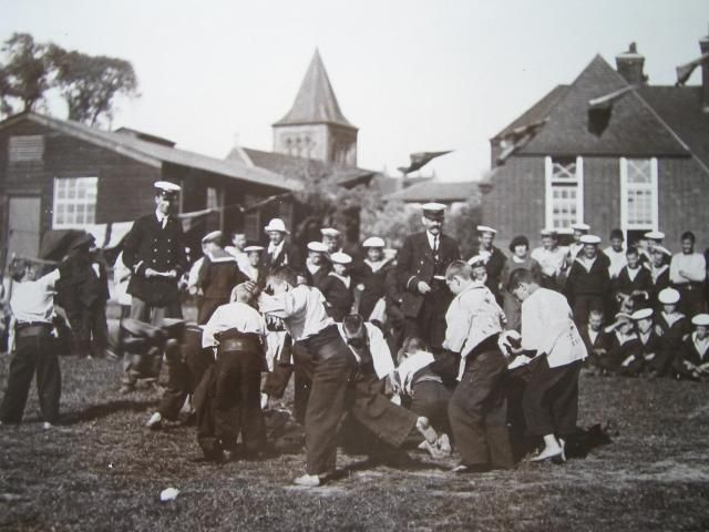 Boys from the training ship Exmouth at play at their land base in Grays town. 1920's