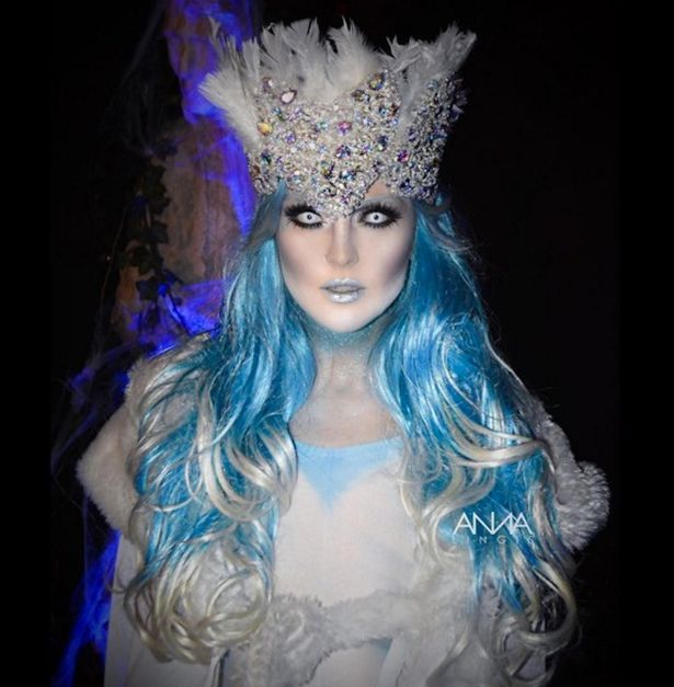 perrie edwards dons a blue wig and an all white and glittery outfit to become